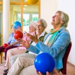 happy elderly ladies playing with a ball